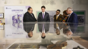 Prime Minister Justin Trudeau, second from left, and MP Darrell Samson tour the Black Cultural Centre for Nova Scotia with community leaders in Halifax on Thursday, February 21, 2019. THE CANADIAN PRESS/Darren Calabrese