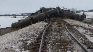 Derailed rail cars near St-Lazare, Man. are shown in a handout photo from the Transportation Safety Board. (THE CANADIAN PRESS/HO-Transportation Safety Board)