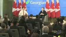 Federal Finance Minister Bill Morneau holds a town