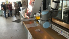 Robot pouring drinks at brewery