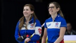 British Columbia skip Sarah Wark, left, and third Kristen Pilote share a light moment as they play Manitoba in tiebreaker action at the Scotties Tournament of Hearts at Centre 200 in Sydney, N.S. on Thursday, Feb. 21, 2019. British Columbia won 8-5 and advance to the championship pool. THE CANADIAN PRESS/Andrew Vaughan