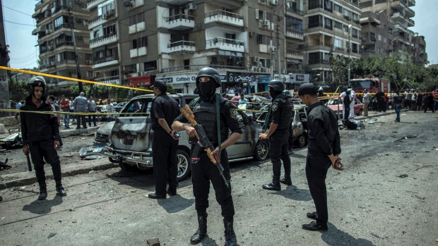 In this June 29, 2015 file photo, Egyptian policemen stand guard at the site of a bombing that killed Egypt's top prosecutor, Hisham Barakat, who oversaw cases against thousands of Islamists, in Cairo. (AP Photo/Eman Helal, File)