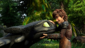 "This image released by Universal Pictures shows characters Toothless, left, and Hiccup, voiced by Jay Baruchel, in a scene from DreamWorks Animation's ""How to Train Your Dragon: The Hidden World."" (DreamWorks Animation/Universal Pictures via AP)"