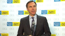 Bill Morneau speaking in Toronto