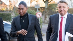 South Africa's runner Caster Semenya, left, current 800-metre Olympic gold medalist and world champion, and her lawyer Gregory Nott, right, arrive for the first day of a hearing at the international Court of Arbitration for Sport, CAS, in Lausanne, Switzerland, Monday, Feb. 18, 2019. (Laurent Gillieron/Keystone via AP)