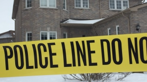 Police tape remains in front of a home in Barrie, Ont. on Thurs., Feb. 21, 2019 (CTV News/Steve Mansbridge)
