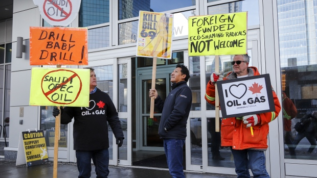 Oil and gas supporters picket outside the National Energy Board, during the release of the board's reconsideration report on marine shipping related to the Trans Mountain expansion project, in Calgary, Friday, Feb. 22, 2019. (THE CANADIAN PRESS/Jeff McIntosh)
