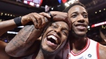 Toronto Raptors' Kyle Lowry, left, and DeMar DeRozan celebrate after defeating the Milwaukee Bucks in NBA basketball action in Toronto on Monday, January 1, 2018. THE CANADIAN PRESS/Frank Gunn