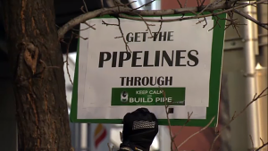 Supporters chanted 'build that pipe' while rallying outside the NEB office in Calgary.