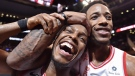 Toronto Raptors' Kyle Lowry, left, and DeMar DeRozan celebrate after defeating the Milwaukee Bucks in NBA basketball action in Toronto on Monday, January 1, 2018. Kyle Lowry's intention was to do his two year's time in Toronto then hightail it to another NBA team. (THE CANADIAN PRESS/Frank Gunn)