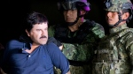"In this Jan. 8, 2016 file photo, a handcuffed Joaquin ""El Chapo"" Guzman is made to face the press as he is escorted to a helicopter by Mexican soldiers and marines at a federal hangar in Mexico City. (AP Photo/Eduardo Verdugo, File)"