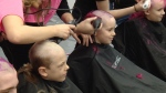 Hundreds shave their heads to raise funds for cancer research at Hair Massacure.