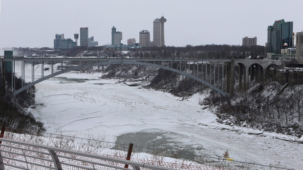 An ice bridge has formed across the Niagara River beneath the Rainbow  Bridge in Niagara Falls 2a90b6cbe