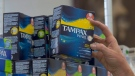 In this June 22, 2016 file photo, Tammy Compton restocks tampons at Compton's Market, in Sacramento, Calif. (AP Photo/Rich Pedroncelli,file)