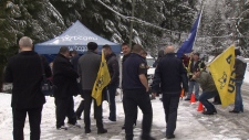 BCGEU members, friends, and family rally for four guards charged with assaulting in inmate in November 2018.
