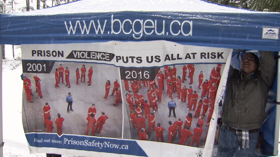 BCGEU banner hanging from a tent shows alleged increase in prison violence against guards.