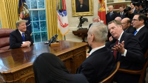 President Donald Trump, left, talks at the same time that U.S. Trade Representative Robert Lighthizer, second from right, talks with Chinese Vice Premier Liu He, second from left, during their meeting in the Oval Office of the White House in Washington, Friday, Feb. 22, 2019. (AP Photo/Susan Walsh)