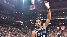 San Antonio Spurs guard DeMar DeRozan (10) acknowledges the fans as he receives a standing ovation during first half NBA basketball action against the Toronto Raptors in Toronto on Friday, Feb. 22, 2019. (THE CANADIAN PRESS/Frank Gun)