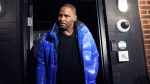 Musician R. Kelly emerges from his Chicago studio Friday night, Feb. 22, 2019. R&B star R. Kelly arrived Friday night at a Chicago police precinct, hours after authorities announced multiple charges of aggravated sexual abuse involving four victims, including at least three between the ages of 13 and 17. (Abel Uribe/Chicago Tribune via AP)