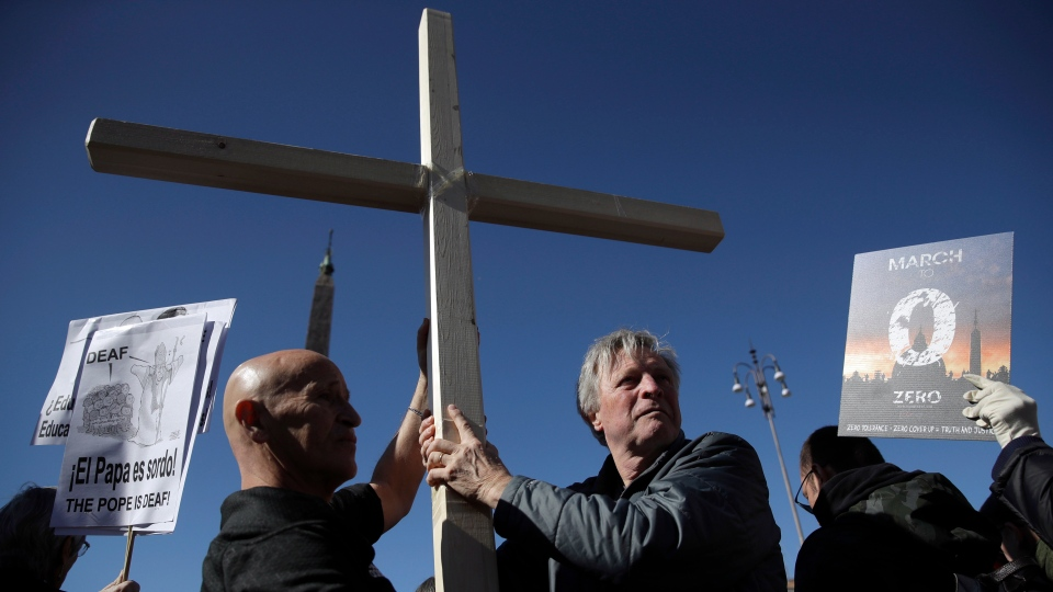 Sex abuse survivors and members of the ECA (Ending Clergy Abuse), hold a wooden cross as they march in downtown Rome, Saturday, Feb. 23, 2019. (AP Photo/Alessandra Tarantino)
