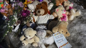 A memorial of flowers and stuffed animal toys is seen outside the scene of a fatal house fire in the Spryfield community in Halifax on Wednesday, February 20, 2019. The early-morning fire claimed the lives of seven Syrian refugee children and left the surviving mother and father in hospital. THE CANADIAN PRESS/Darren Calabrese