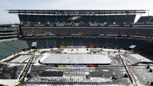 An insulated tarp covers the ice ahead of the NHL Winter Classic hockey game between the Pittsburgh Penguins and Philadelphia Flyers, in Philadelphia, Thursday, Feb. 21, 2019. (AP Photo/Matt Rourke)