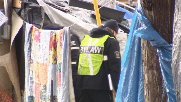 Bylaw officers and firefighters entered the Anita Place homeless camp in Maple Ridge.