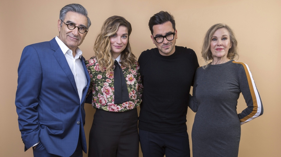 Eugene Levy, from left, Annie Murphy, Daniel Levy and Catherine O'Hara cast members in the Pop TV series
