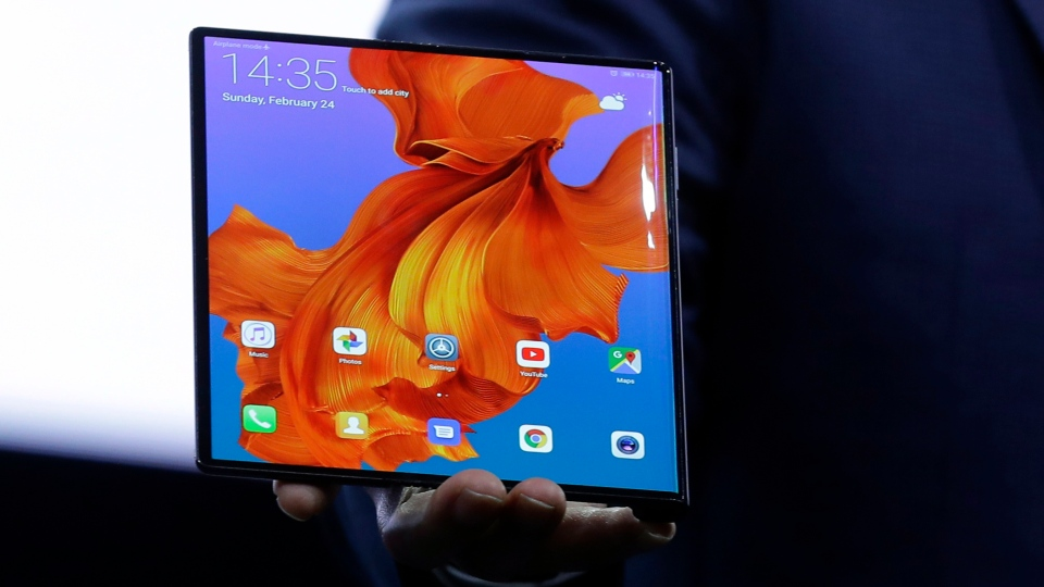 Huawei CEO Richard Yu displays the new Huawei Mate X foldable 5G smartphone at the Mobile World Congress, in Barcelona, Spain, Sunday, Feb. 24, 2019. The fair started with press conferences on Sunday, before the doors open on Monday, Feb. 25, and runs until Feb. 28. (AP Photo/Manu Fernandez)