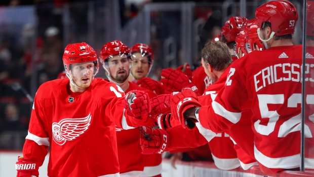 5ce5b16706c Detroit Red Wings right wing Gustav Nyquist (14) celebrates his goal against  the San Jose Sharks in the first period of an NHL hockey game Sunday