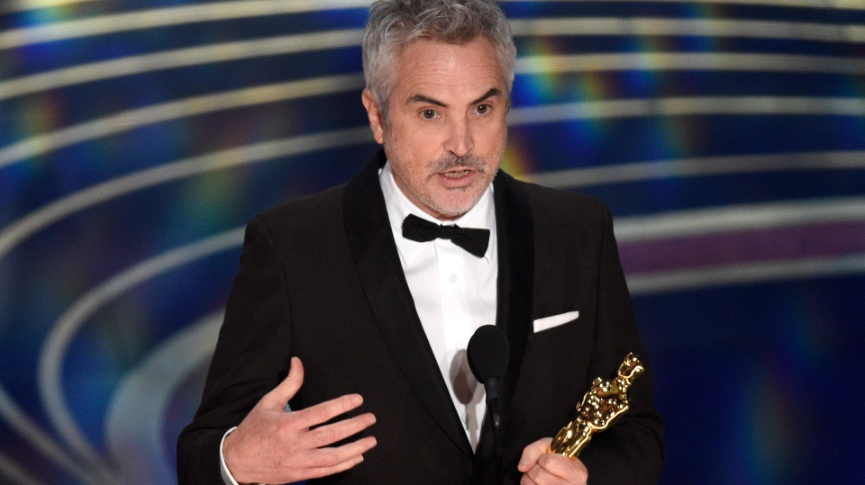 50e1e71d5a22 Alfonso Cuaron accepts the award for best cinematography for 'Roma' at the  Oscars on Sunday, Feb. 24, 2019, at the Dolby Theatre in Los Angeles.