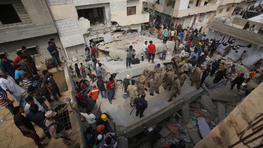 Pakistan building collapse kills 2 in Karachi, traps others