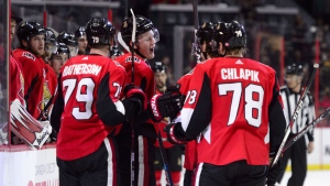 Ottawa Senators left wing Brady Tkachuk (7) celebrates a goal against the Calgary Flames during second period NHL hockey action in Ottawa on Sunday, Feb. 24, 2019. THE CANADIAN PRESS/Sean Kilpatrick