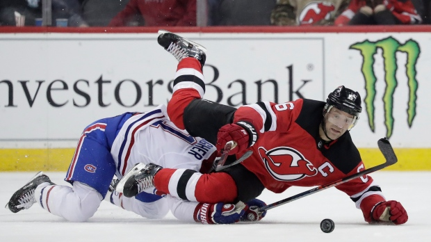 a4756de68a4 New Jersey Devils defenseman Andy Greene (6) is tripped by Montreal  Canadiens right wing Brendan Gallagher (11) during the second period of an  NHL hockey ...