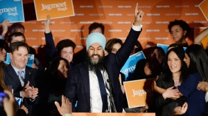 NDP leader Jagmeet Singh celebrates his Burnaby South byelection win as he arrives at his election night party in Burnaby, B.C., Monday, Feb. 25, 2019. (THE CANADIAN PRESS/Jonathan Hayward)