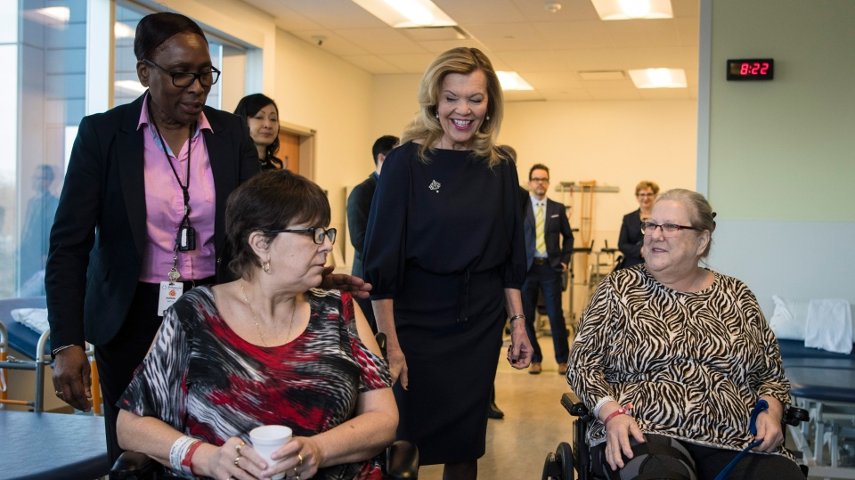 Christine Elliott, Deputy Premier and Minister of Health and Long-Term Care, greets patients at Bridgepoint Active Healthcare before making an announcement in Toronto on Tuesday, February 26, 2019. THE CANADIAN PRESS/ Tijana Martin