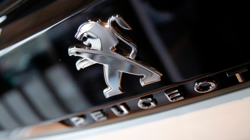 In this Feb.23, 2017 file photo, the logo of French automaker Peugeot is pictured in Paris. (AP Photo/Christophe Ena, File)