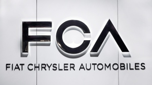 In this Monday, Jan. 14, 2019 file photo, Fiat Chrysler Automobiles FCA logo is shown at the North American International Auto Show in Detroit. (AP Photo/Paul Sancya, file)