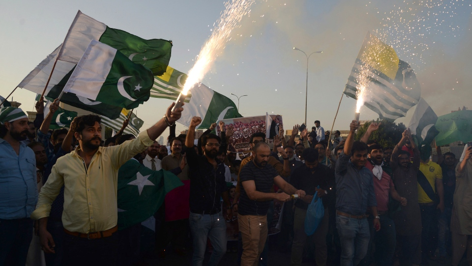 People celebrate the shooting down of Indian planes by Pakistani forces, with fireworks, in Karachi, Pakistan, Wednesday, Feb. 27, 2019. (AP Photo/Muhammad Rizwan)
