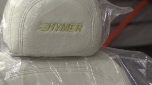 A leather headrest reading 'Hymer'