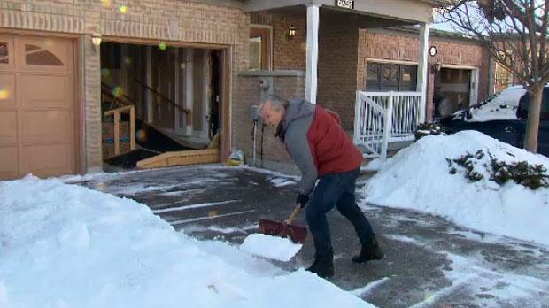 Ron Vankeulen is seen shoveling his mother's driveway.
