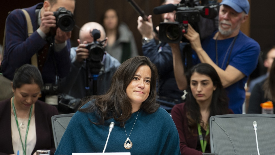 Cameras follow Jody Wilson-Raybould as she waits to appear in front of the Justice committee in Ottawa, Wednesday Feb. 27, 2019. THE CANADIAN PRESS/Adrian Wyld