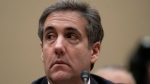 Michael Cohen, President Donald Trump's former lawyer, testifies before the House Oversight and Reform Committee, on Capitol Hill, Wednesday, Feb. 27, 2019, in Washington. (AP Photo/J. Scott Applewhite)