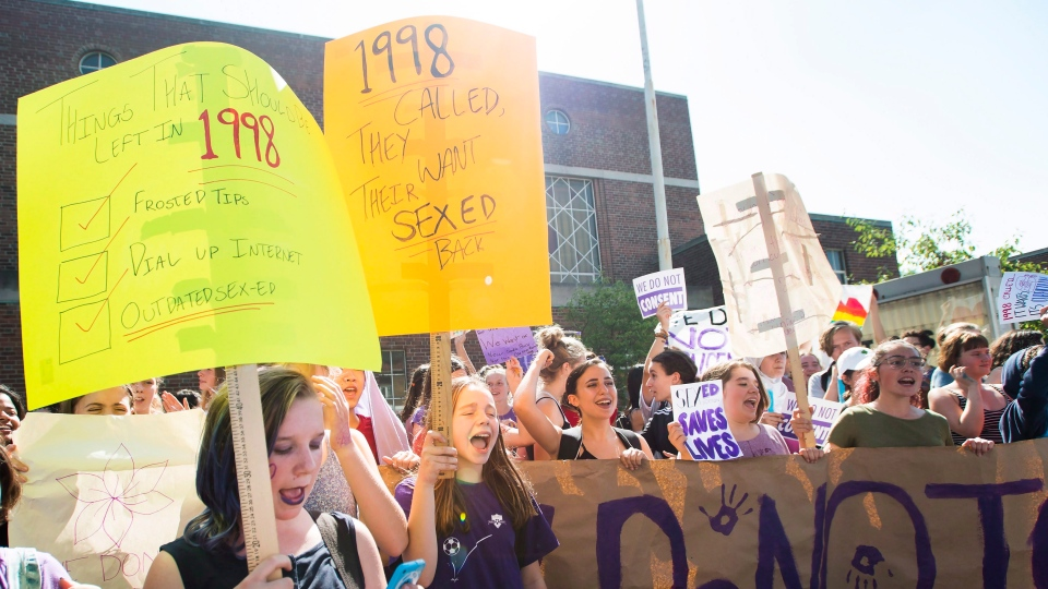Students at Bloor Collegiate Institute walk out of class to protest sex-ed curriculum changes in Toronto on Friday, September 21, 2018. THE CANADIAN PRESS/Nathan Denette