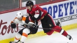 Ottawa Senators defenceman Mark Borowiecki collides with Philadelphia Flyers defenceman Shayne Gostisbehere behind the net during second period NHL action Thursday October 26, 2017 in Ottawa. THE CANADIAN PRESS/Adrian Wyld