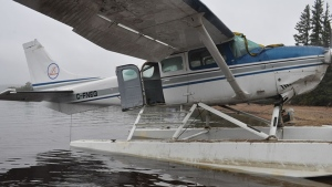 A float plane which crashed in the Northwest Territories is shown in a Transportation Safety Board handout photo. (THE CANADIAN PRESS/HO-Transportation Safety Board)