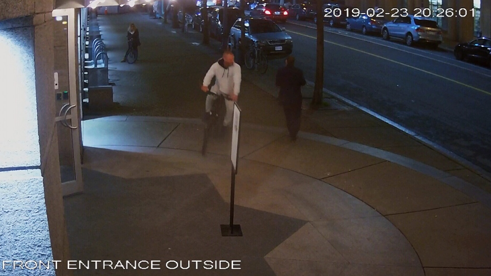A still image from surveillance camera video shows a man cycling away with what police believe may be Mahshid Hadi's bike.
