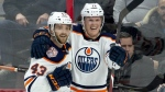 Edmonton Oilers centre Colby Cave(12) celebrates his goal with teammate Josh Currie during third period NHL action against the Ottawa Senators, in Ottawa, Thursday, Feb. 28, 2019. The Oilers defeated the Senators 4-2. THE CANADIAN PRESS/Adrian Wyld