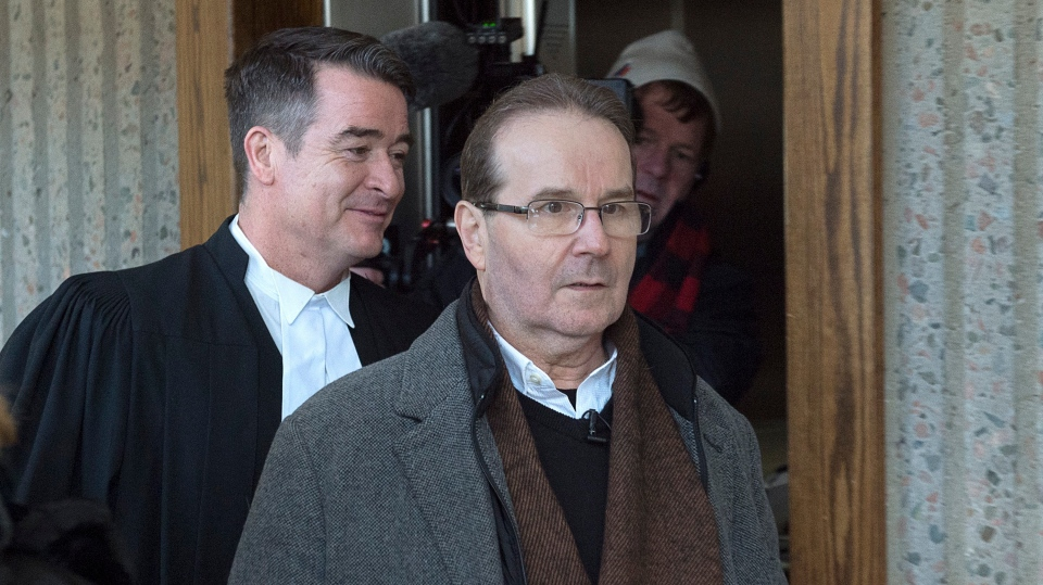 Glen Assoun, right, arrives at Nova Scotia Supreme Court with his lawyer Sean MacDonald in Halifax on Friday, March 1, 2019. (THE CANADIAN PRESS/Andrew Vaughan)