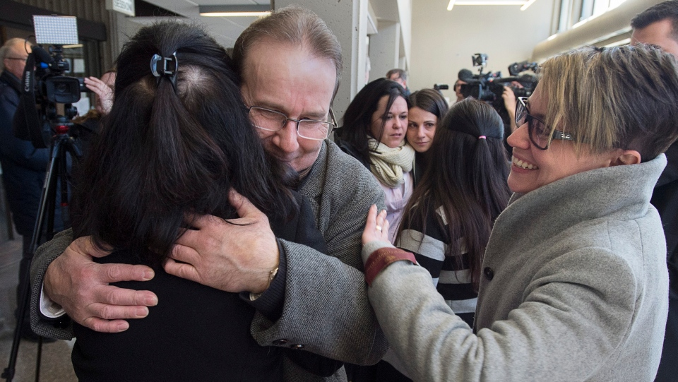 Glen Assoun is greeted by family and friends at Nova Scotia Supreme Court in Halifax on Friday, March 1, 2019. (THE CANADIAN PRESS/Andrew Vaughan)